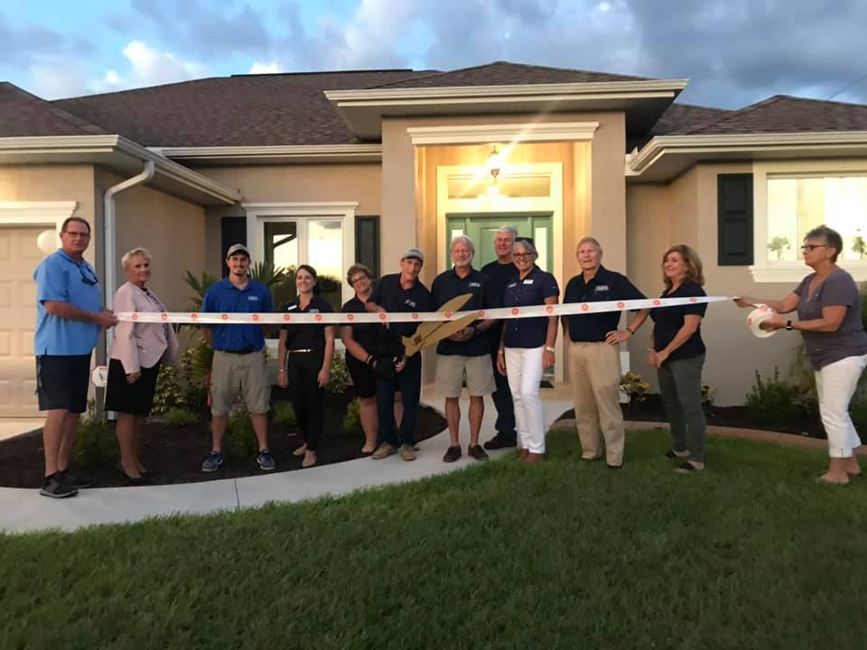 Hamsher Homes ribbon cutting in front of model home