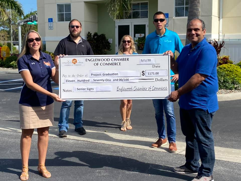 5 people holding gigantic check