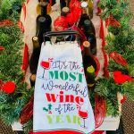 Wagon full of Wine Bottles with cloth saying: It's the most wonderful wine of the year